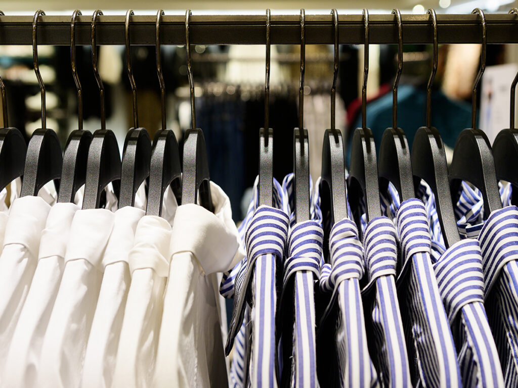 Rack of white and striped button-up shirts
