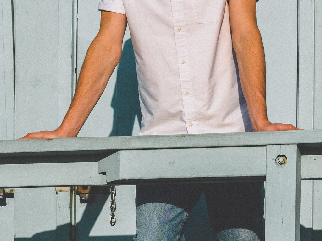 image of man wearing a white button-up shirt.